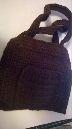 Color: Brown. Small hand held purse