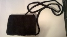 Color: Black Change or phone carrying case with extra long handle