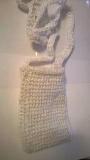 Color: White with silver glitter thread throughout. Purse/Cell phone holder. Smaller phones.